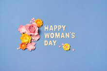 Creative Layout Made With Pink And Yellow Flowers On Bright Background. Flat Lay. Woman's Day Minimal Concept.