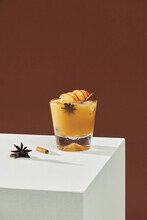 Fruit Alcohol Cocktail With Apple And Cinnamon Stick Isolated On Table