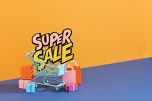 Shopping Cart And Paper Bag With Super Sale Text