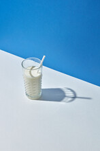 Organic Milk In A Glass With Papercraft Straw.