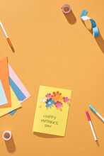 Paper Crafts For Mother's Day. Small Child Doing A Bouquet Of Flowers Out Of Colored Paper For Mom. Simple Gift Idea. View Top, Copy Space