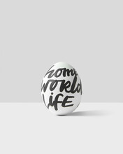 Easter Egg With Text - Home, World, Life.