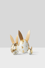 Painted Golden Easter Eggs With Ears.