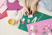 Woman's Hand Cut Paper. Artist Doing Paper Craft.