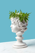 Gypsum Boy's Statue With Cannabis Wreath.