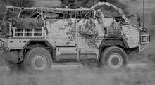 British Army Supacat Jackal Rapid Assault, Fire Support And Reconnaissance Vehicles On A Military Exerciase, Salisbury Plain UK