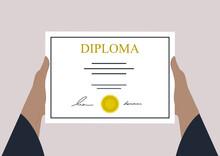 Hands Holding A High School Graduation Certificate