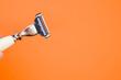 Closeup shot of a man's razor on orange background