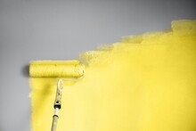 Demonstrating Trendy Color Of The Year 2021. Illuminating Yellow And Ultimate Gray. Brush And Open Paint Can With On Color Background. Appartment Renovation, Repair, Building And Home Design Concept