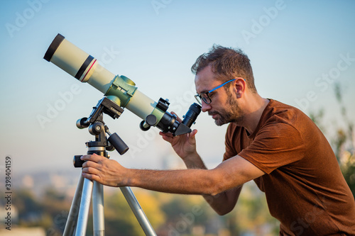 Obraz na plátne Amateur astronomer looking at the sky with a telescope.