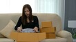 shocked frustrated woman customer open cardboard box receive wrong or damaged shopping order parcel on the online store