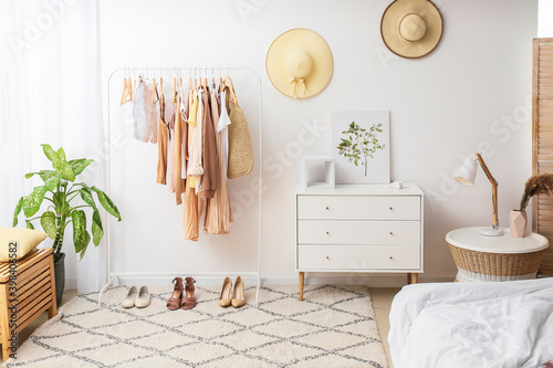 Slika na platnu Interior of stylish bedroom with clothes rack