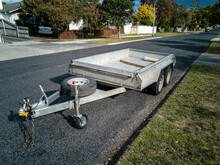 AUCKLAND, NEW ZEALAND - Mar 29, 2020: 2-axle Flatbed Trailer Parked In Suburban Street