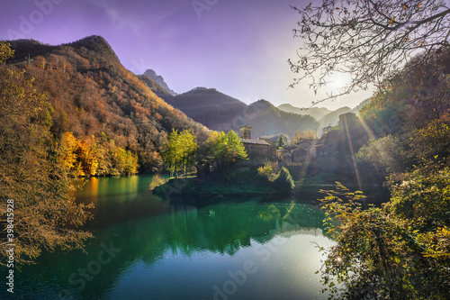 Isola Santa medieval village and lake in autumn foliage. Garfagnana, Tuscany, Italy.