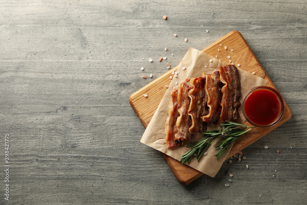 Fototapeta Concept of tasty snack with board of fried bacon