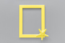 Yellow Frame With Starfish On Grey Background. Trendy Colors 2021.