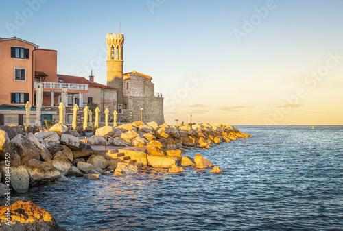 Coast of Piran with old church, Slovenia Fotobehang
