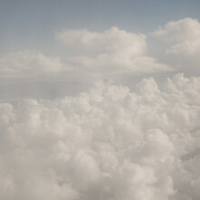 Flyffy White Cumulus Clouds Seen From Above
