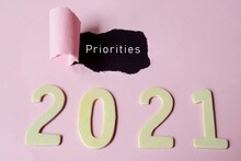 Priorities Text On Torn Paper With Year 2021 Background