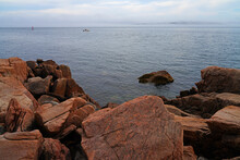 View Of Pink Granite Stones And Boats In The Water In Mount Desert Island, Maine, United States, Near The Bass Harbor Head Light