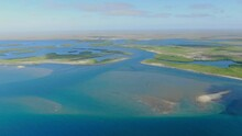Aerial View Moving Forward Shot, Scenic View Of Mangrove Forest In Adolfo Lopez Mateos Baja California Sur, Mexico, Blue Sky In The Background.