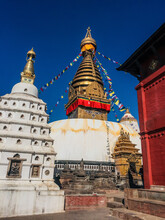 Stupa In Kathmandu,Beautiful Photo Of Swayambunath Temple With Clear Blue Sky In The Background And Posterization Color Effect With Selective Focus Toward Golden White Stupa.