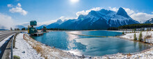 Rundle Forebay Reservoir In Winter Sunny Day Morning. Clear Blue Sky, Snow Capped Mount Lawrence Grassi Mountain Range In Background. Canmore, AB, Canada.