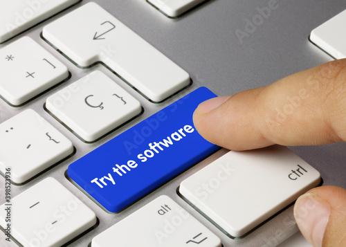 Fotografie, Obraz Try the software - Inscription on Blue Keyboard Key.