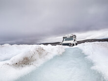 Off Road Vehicle On Snow Land Against Cloudy Sky, Langjokull, Iceland