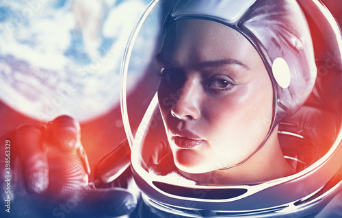 Tela female astronaut in space behind earth blurred with glass helmet and dramatic li