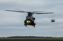 Two Heavy Lift Military Helicopters Returning To Base At Dusk