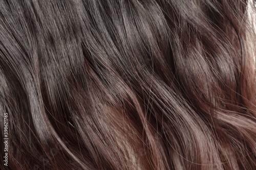 Fototapeta close up texture of  clip in straight black blended to auburn two tone ombre style synthetic  hair extensions obraz