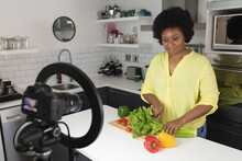 African American Female Vlogger Recording A Video In Kitchen