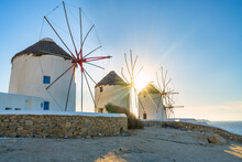 Windmills Of Mykonos With Sunset Flare, Greece
