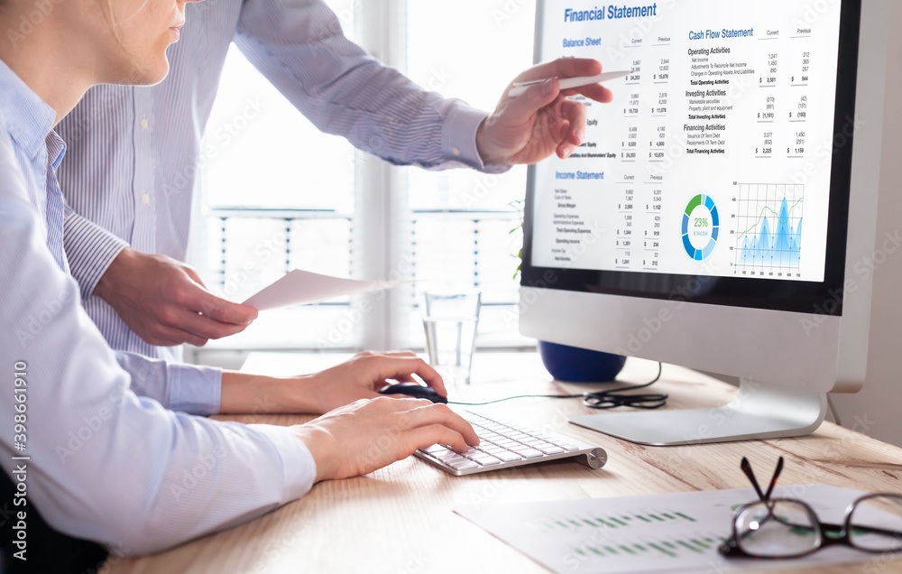Fototapeta Accountants working on financial statement on computer screen in office. Team of consulant auditing finance and business operations reports with income data. Corporate management and governance