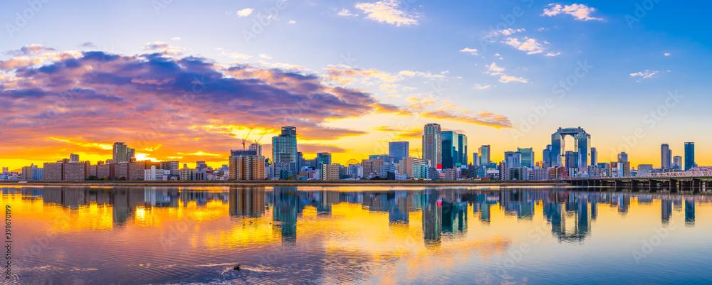 Fototapeta Beautiful sunrise view of Osaka city skyline. Japan