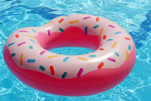 Inflatable Ring In Donut Shape In A Clear Water Of Swimming Pool. Beach Vacation, Relax And Leisure Concept