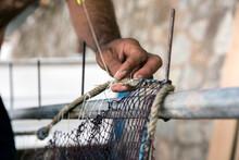 Fisherman Repairing Fishing Nets.