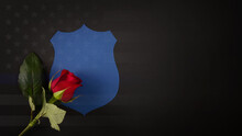 Blue Shield With A Red Rose Draped Across It. National Law Enforcement Officers Memorial Fund Symbol