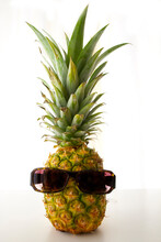 """Pineapple With Sunglasses.Because The Pineapple Is A Tropical Fruit, """"joy"""" Is A Common Meaning Given For All. You Can Mean A Bunch Of Different Things"""