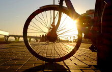 A Wheel Of Bicycle In The Evening, The Sunset Light, Winter Time, In Saint-Petersbug, Russia