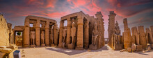 Sculptures Of Ancient Egyptian Pharaohs And Drawings On The Columns Of The Luxor Temple In The Evening. Egypt
