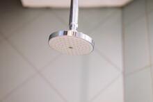 Shower Head Against Bathroom Tiles