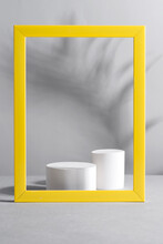Yellow Frame With Palm Shadows And White Geometric Podiums On Grey Background. Trendy Colors 2021.