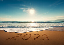 Beautiful Sunrise Over The Sea. Happy New Year 2021 Written On Seashore.