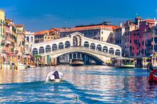 Tourist On The Motor Boat Heading Towards Rialto Bridge In Venice. Holiday Concept