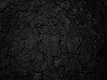 Black Abstract Background. Black Grunge Texture. Cracked Paint Surface.