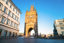 Tower Of Charles Bridge With The Statue Of Charles IV In Prague. Czech Republic