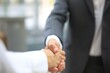 Business partnership handshake concept.Photo two coworkers handshaking process.Successful deal after a great meeting.