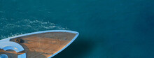 Aerial Drone Ultra Wide Top Down Photo Of Luxury Exotic Yacht Nose With Wooden Deck Anchored In Paradise Turquoise Bay